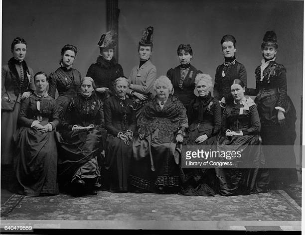 Longtime women's rights activist Elizabeth Cady Stanton front row fourth from left sits with executive committee members from the International...
