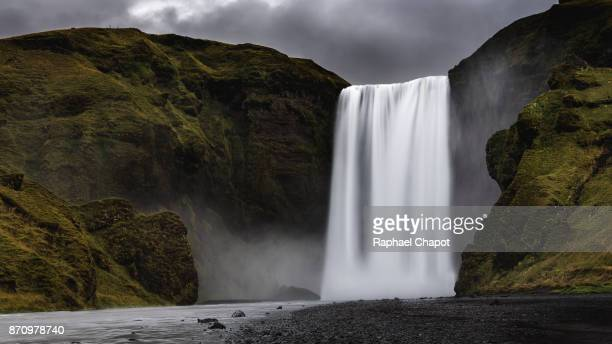 longue exposure photographe at skagafoss during moody weather, south of iceland. - south africa stock pictures, royalty-free photos & images