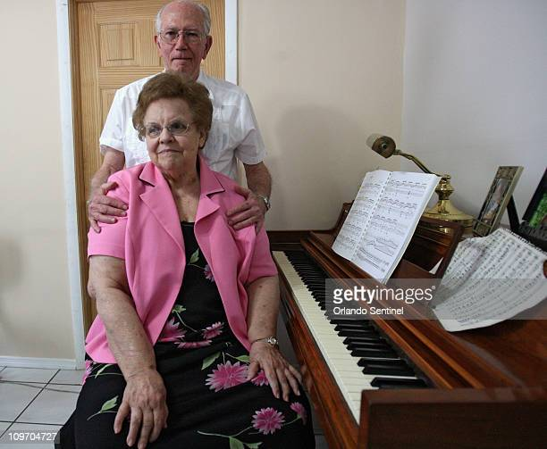 Longwood Florida resident Alicia Harper front sits with her husband Nildo Harper in their home she played the piano February 25 2011 Alicia Harper...