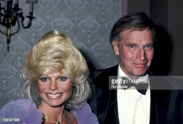 Loni Anderson and Charlton Heston during USO Distinguished Award to Dolores Hope at Beverly Hilton Hotel in Beverly Hills California United States