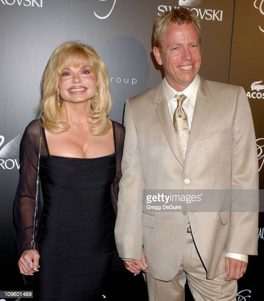 Loni Anderson and Christopher Lawrence during 8th Annual Costume Designers Guild Awards Gala Arrivals at Beverly Hilton Hotel in Beverly Hills...