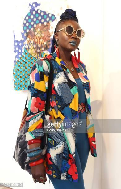 Loni Johnson wears Washington Avenue Vintage and Wild Child Dzigns at PRIZM Art Fair as part of the 2018 Art Basel Miami Beach art fair on December 7...