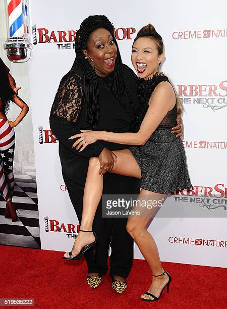 """Loni Love and Jeannie Mai attend the premiere of """"Barbershop: The Next Cut"""" at TCL Chinese Theatre on April 6, 2016 in Hollywood, California."""