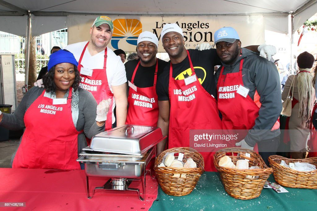 Loni Love, Brandon Molale, Edwin Hodge, Aldis Hodge and Catfish Jean are seen at the Los Angeles Mission's Christmas Celebration on Skid Row on December 22, 2017 in Los Angeles, California.