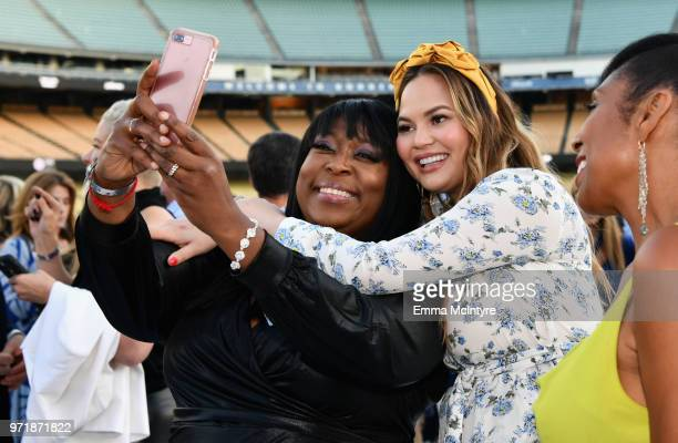 Loni Love Chrissy Teigen Dawnn Lewis attend the Fourth Annual Los Angeles Dodgers Foundation Blue Diamond Gala at Dodger Stadium on June 11 2018 in...
