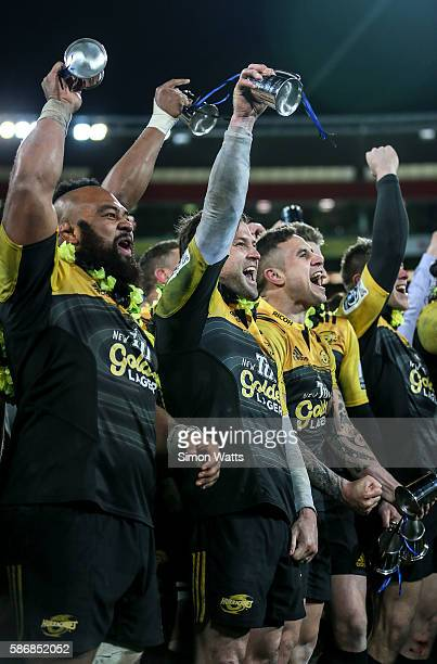 L_R Loni Uhila Cory Jane and TJ Perenara celebrate after winning the 2016 Super Rugby Final match between the Hurricanes and the Lions at Westpac...