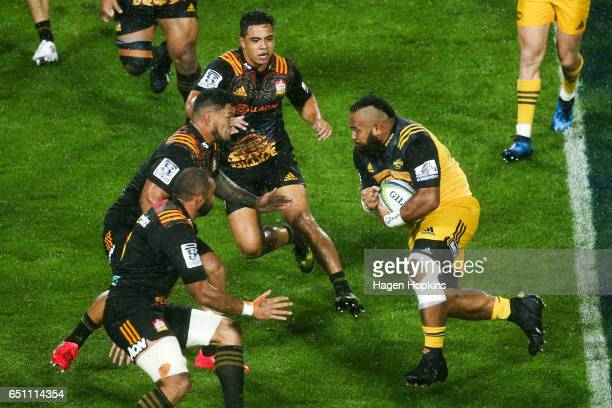 Loni Uhila of the Hurricanes runs at Hika Elliot of the Chiefs during the round three Super Rugby match between the Chiefs and the Hurricanes at FMG...