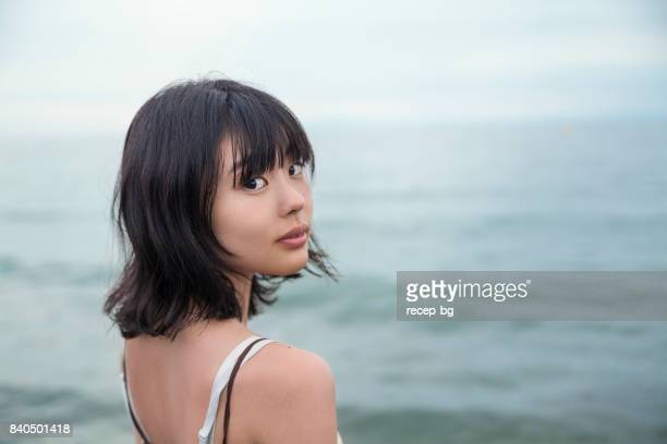 Lonly Young Woman By The Sea