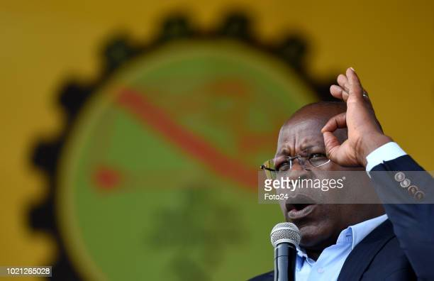 Lonmin CEO Bennetor Magara addresses the audience during an event to commemorate the sixth anniversary of the Marikana massacre on August 16, 2018 in...