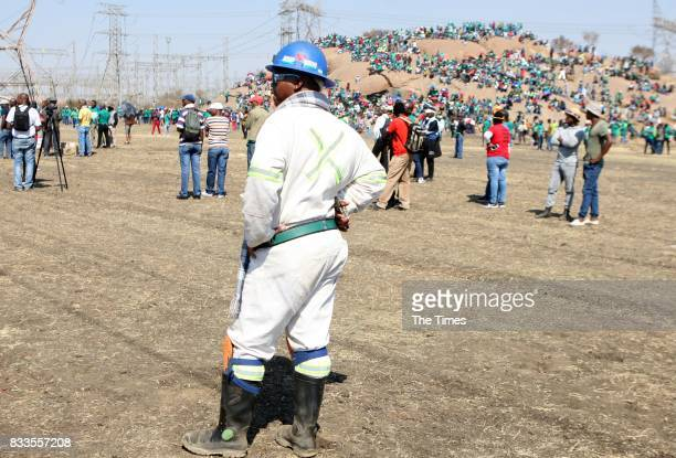 Lonmin mineworker attends the fifth anniversary commemoration of the Marikana massacre at Wonderkop on August 16, 2017 in Rustenburg, South Africa....