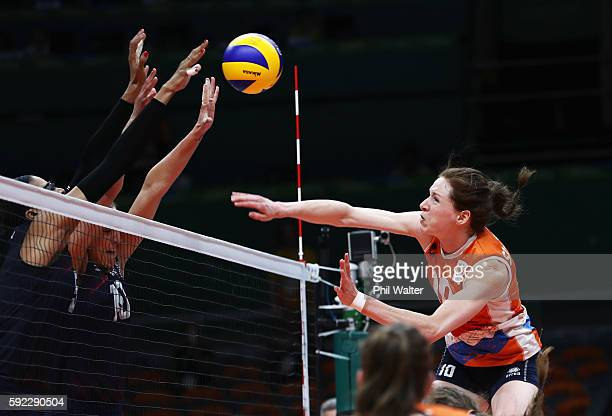 Lonneke Sloetjes of Netherlands spikes the ball against Jordan LarsonBurbach and Rachael Adams of United States during the Women's Bronze Medal Match...