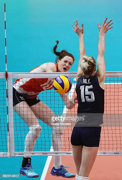 Lonneke Sloetjes of Netherlands spikes the ball against Kimberly Hill of United States during the Women's Bronze Medal Match between Netherlands and...