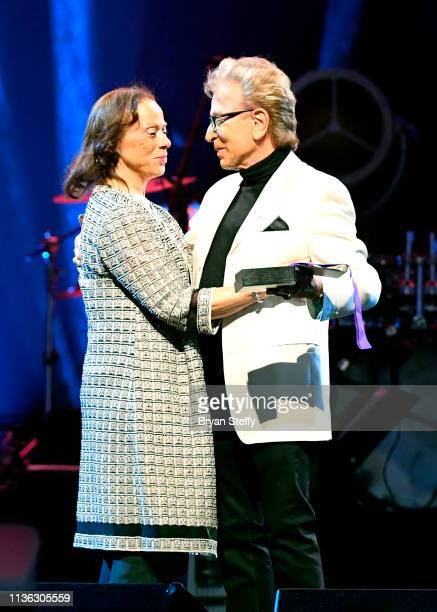 Lonnie Ali and Siegfried Fischbacher embrace onstage during the 23rd annual Keep Memory Alive 'Power of Love Gala' benefit for the Cleveland Clinic...