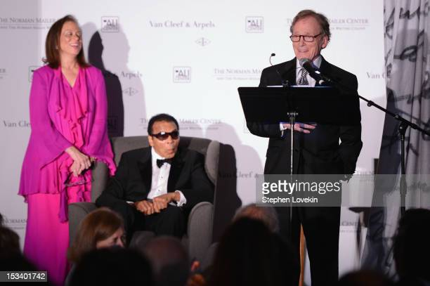 Lonnie Ali Muhammad Ali and Dick Cavett pose onstage during the Norman Mailer Center 4th Annual Benefit Gala on October 4 2012 in New York City