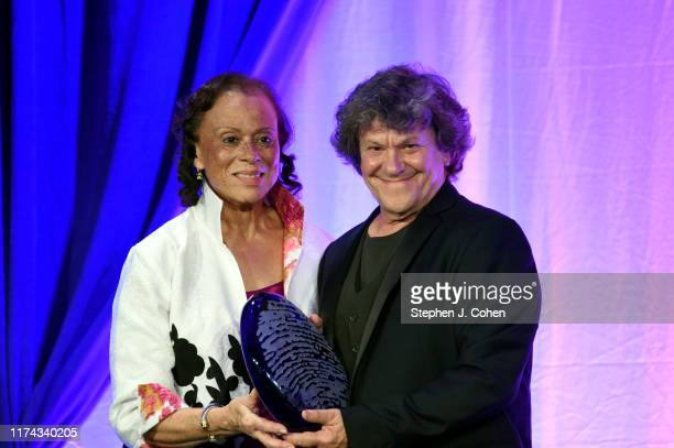 Lonnie Ali presents Michael Lang with the Lifetime Achievement Award during the 7th Annual Muhammad Ali Humanitarian Awards at Downtown Marriott on...