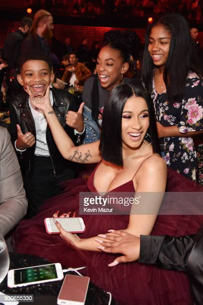 Lonnie Chavis Eris Baker and Cardi B attend the 2018 iHeartRadio Music Awards which broadcasted live on TBS TNT and truTV at The Forum on March 11...