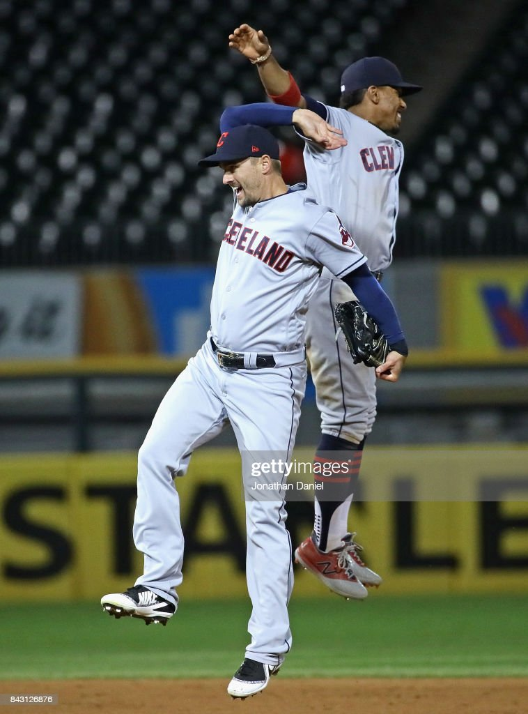 Lonnie Chisenhall #8 (L) and Francisco Lindor #12 of the Cleveland Indians celebrate a win against the Chicago White Sox at Guaranteed Rate Field on September 5, 2017 in Chicago, Illinois. The Indians defeated the White Sox 9-4.