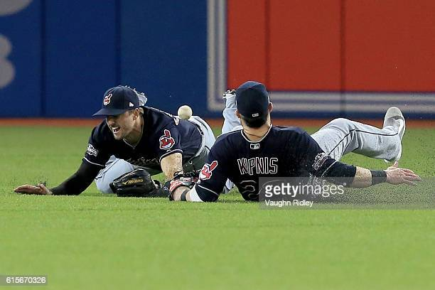 Lonnie Chisenhall and Jason Kipnis of the Cleveland Indians miss a ball hit by Russell Martin of the Toronto Blue Jays in the fifth inning during...