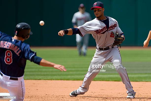 Lonnie Chisenhall is out at second as shortstop Pedro Florimon throws to first for the double play to end the sixth inning at Progressive Field on...