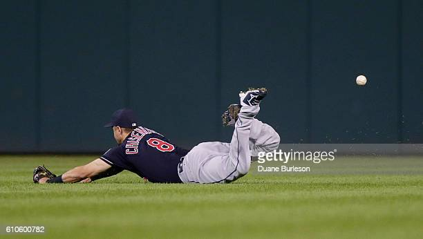 Lonnie Chisenhall of the Cleveland Indians can't come up with the ball off the bat of James McCann of the Detroit Tigers that went for a single...