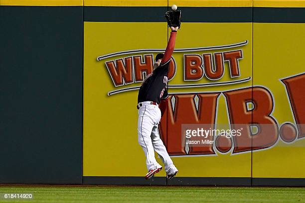 Lonnie Chisenhall of the Cleveland Indians catches a fly ball hit by Jorge Soler of the Chicago Cubs during the second inning in Game Two of the 2016...