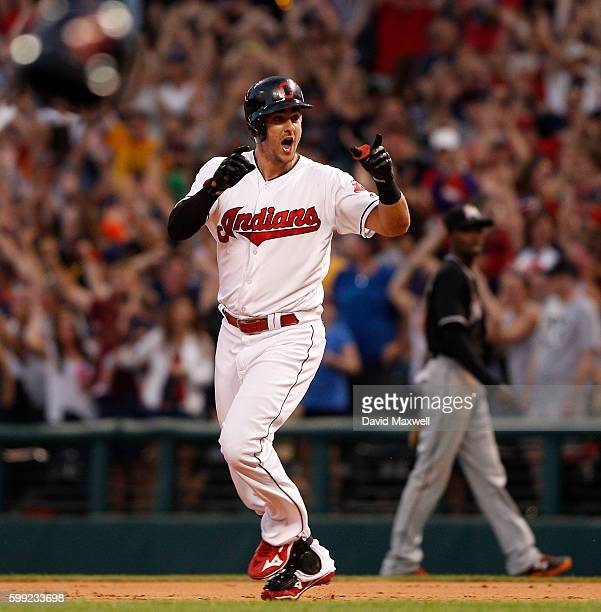 Lonnie Chisenhall of the Cleveland Indians celebrates after hitting the game winning single against the Miami Marlins in the ninth inning of their...