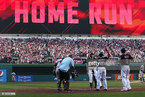 Lonnie Chisenhall of the Cleveland Indians celebrates with Jose Ramirez after hitting a threerun home run in the second inning against the Boston Red...