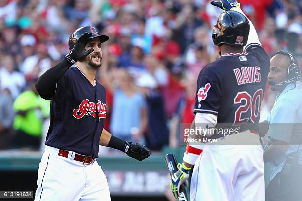 Lonnie Chisenhall of the Cleveland Indians celebrates with Rajai Davis after hitting a threerun home run in the second inning against the Boston Red...