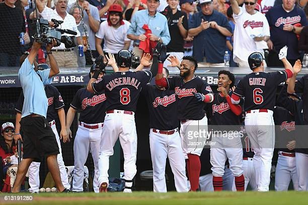 Lonnie Chisenhall of the Cleveland Indians celebrates with teammates at the dugout after hitting a threerun home run in the second inning against the...
