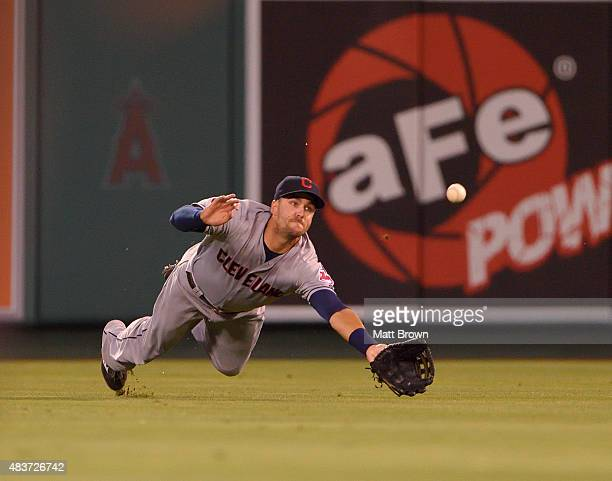 Lonnie Chisenhall of the Cleveland Indians dives while attempting to catch a ball during the game against the Los Angeles Angels of Anaheim at Angel...