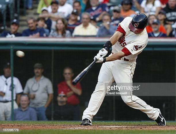 Lonnie Chisenhall of the Cleveland Indians hits a game winning RBI single off of Jose Valverde during the ninth inning of their game on September 16...