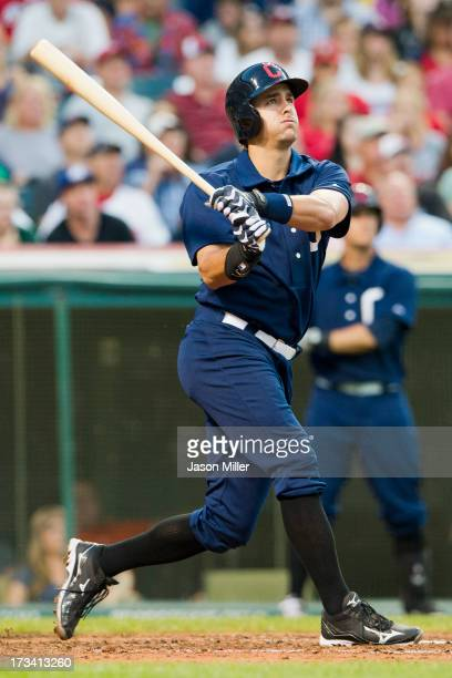 Lonnie Chisenhall of the Cleveland Indians hits a grand slam home run during the sixth inning against the Kansas City Royals at Progressive Field on...