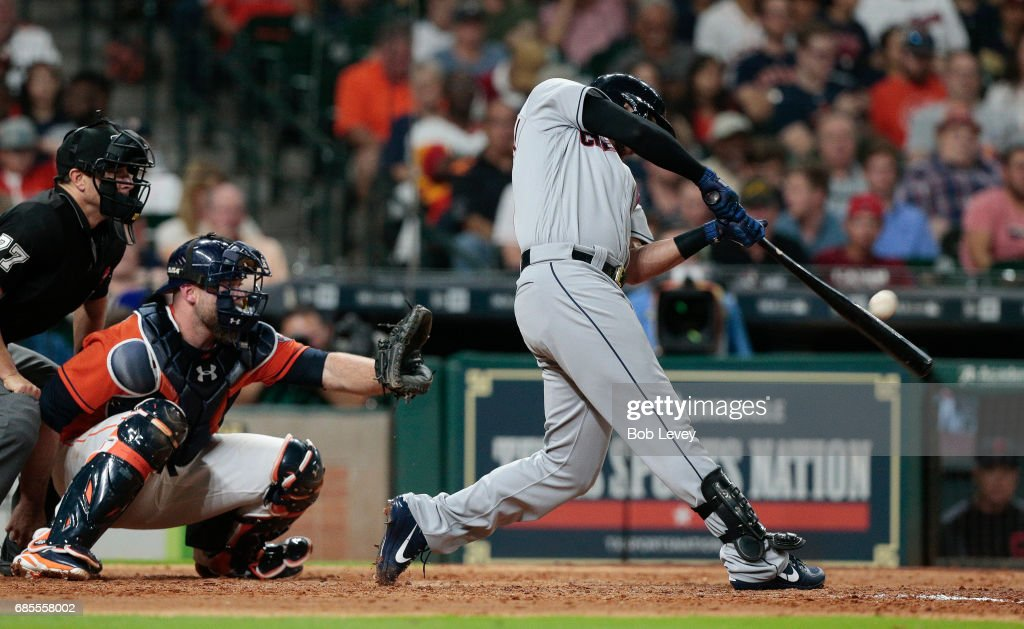 Lonnie Chisenhall #8 of the Cleveland Indians hits a home run in the sixth inning against the Houston Astros at Minute Maid Park on May 19, 2017 in Houston, Texas.