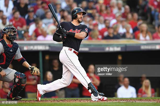 Lonnie Chisenhall of the Cleveland Indians hits a threerun home run in the second inning against the Boston Red Sox during game two of the American...