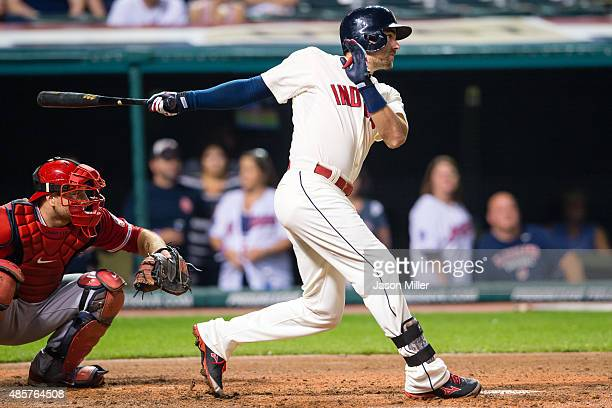 Lonnie Chisenhall of the Cleveland Indians hits a two RBI single during the third inning against the Los Angeles Angels of Anaheim at Progressive...