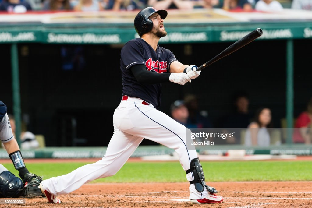 Lonnie Chisenhall #8 of the Cleveland Indians hits an RBI sacrifice fly during the third inning against the San Diego Padres at Progressive Field on JULY 6, 2017 in Cleveland, Ohio.