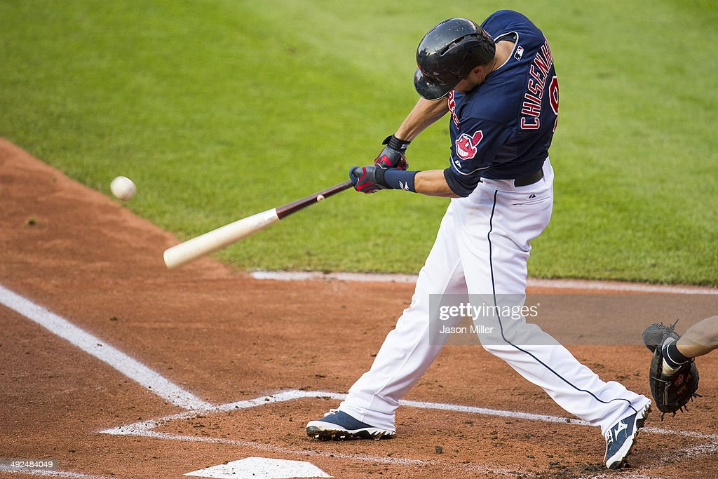 Lonnie Chisenhall #8 of the Cleveland Indians hits an RBI single during the first inning against the Detroit Tigers at Progressive Field on May 20, 2014 in Cleveland, Ohio.