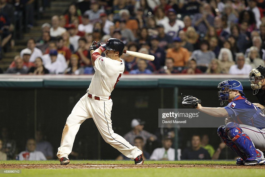 Lonnie Chisenhall #8 of the Cleveland Indians hits an RBI single to score Jason Kipnis #22 (not pictured) against the Texas Rangers during the sixth inning of their game on August 2, 2014 at Progressive Field in Cleveland, Ohio.