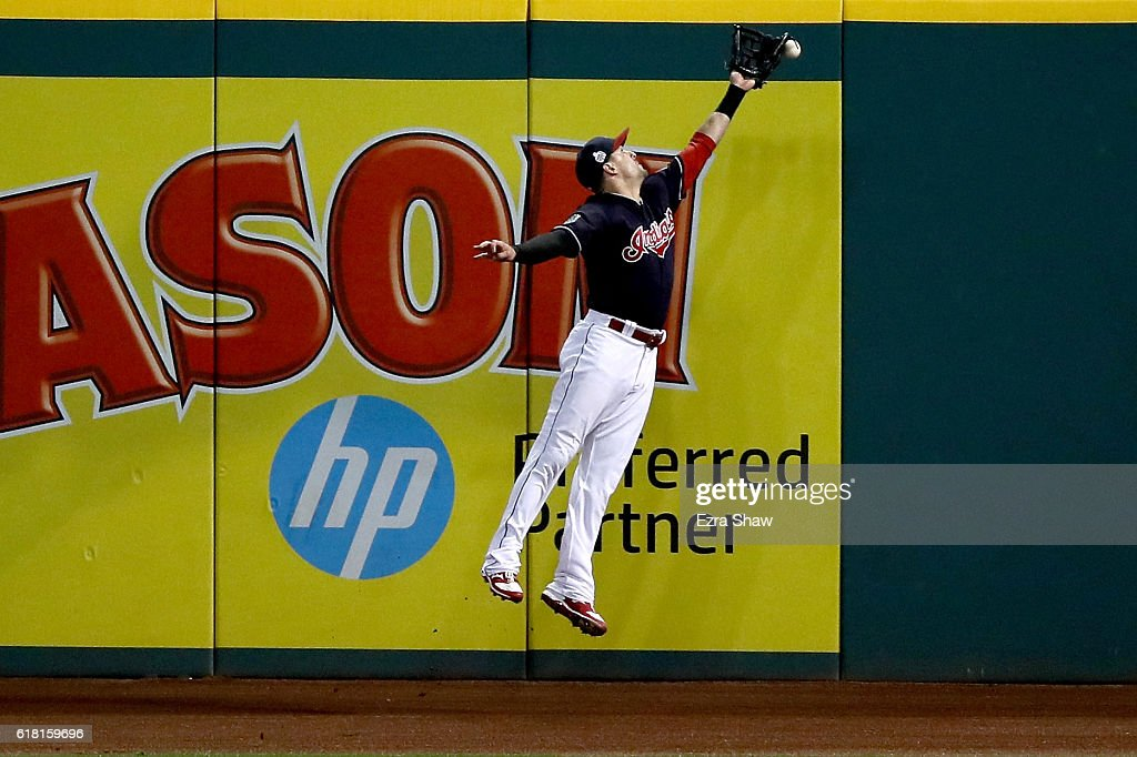 Lonnie Chisenhall #8 of the Cleveland Indians is unable to make a catch on a ball hit by Willson Contreras #40 of the Chicago Cubs in the ninth inning in Game One of the 2016 World Series at Progressive Field on October 25, 2016 in Cleveland, Ohio.