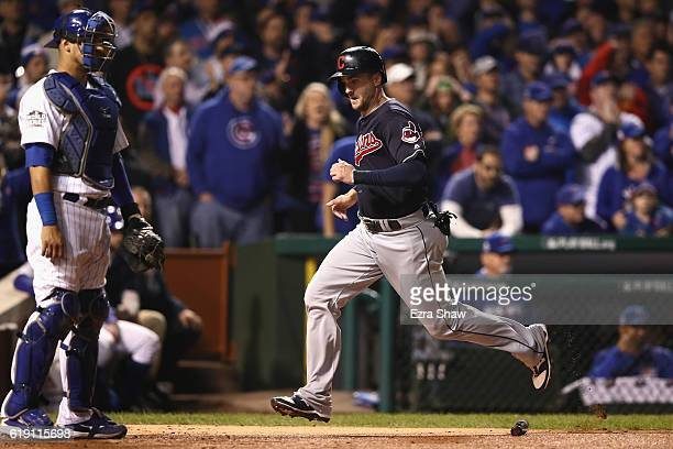 Lonnie Chisenhall of the Cleveland Indians scores a run past Willson Contreras of the Chicago Cubs in the second inning in Game Four of the 2016...