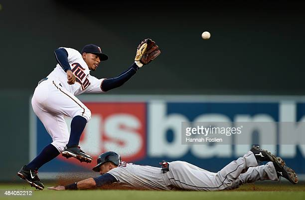 Lonnie Chisenhall of the Cleveland Indians steals second base as Eduardo Escobar of the Minnesota Twins fields the ball during the second inning of...