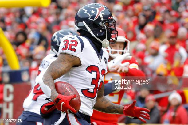 Lonnie Johnson Jr #32 of the Houston Texans recovers and returns a blocked kick of Dustin Colquitt of the Kansas City Chiefs for a touchdown in the...