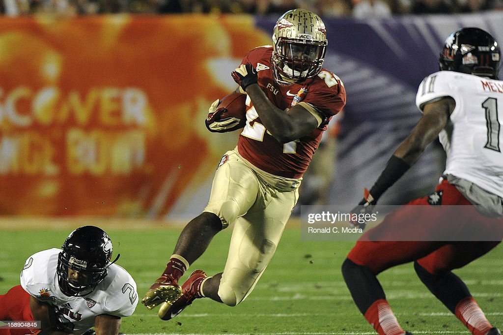 Lonnie Pryor #24 of the Florida State Seminoles carries the ball against the Northern Illinois Huskies during the Discover Orange Bowl at Sun Life Stadium on January 1, 2013 in Miami Gardens, Florida.