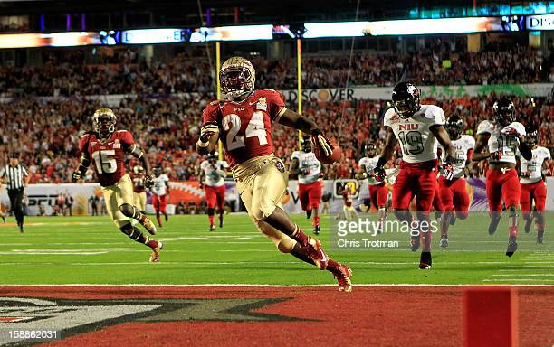 Lonnie Pryor of the Florida State Seminoles scores a 60yard rushing touchdown in the first quarter against the Northern Illinois Huskies during the...