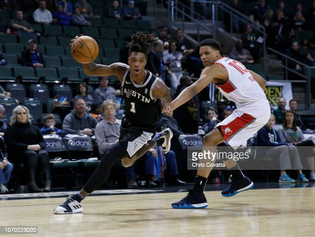 Lonnie Walker IV of the Austin Spurs drives around Ivan Rabb of the Memphis Hustle during a NBA GLeague game on December 8 2018 at the HEB Center At...