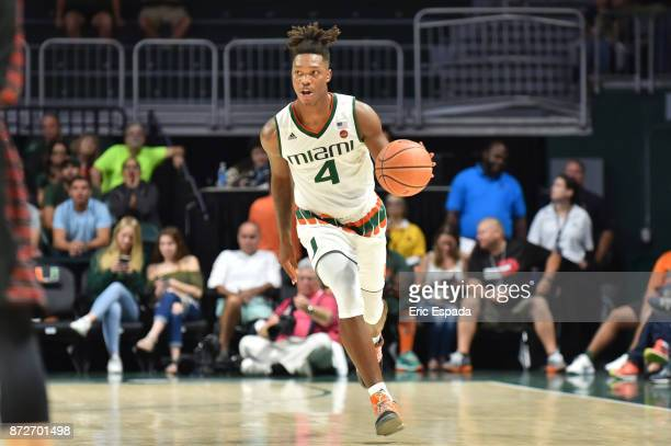 Lonnie Walker IV of the Miami Hurricanes brings the basketball upcoast during the second half against the Gardner Webb Runnin Bulldogs at The Watsco...