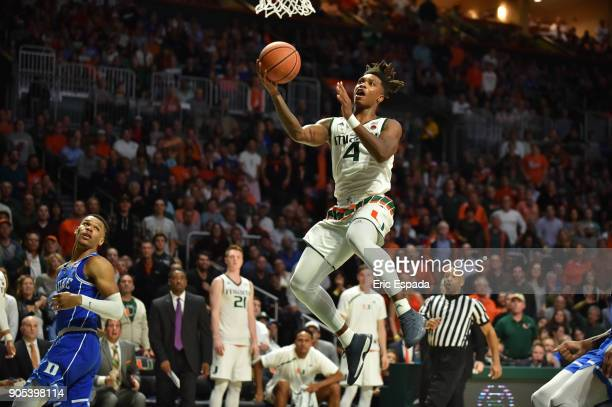 Lonnie Walker IV of the Miami Hurricanes drives to the basket during the second half against the Duke Blue Devils at The Watsco Center on January 15...