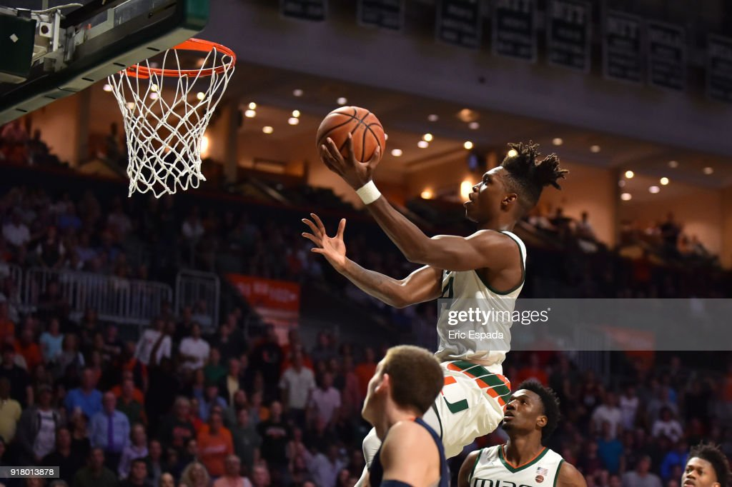 Lonnie Walker IV #4 of the Miami Hurricanes drives to the basket during the second half of the game against the Virginia Cavaliers at The Watsco Center on February 13, 2018 in Miami, Florida.