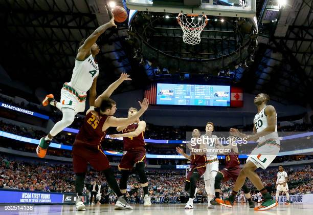 Lonnie Walker IV of the Miami Hurricanes goes up for a shot against Cameron Krutwig of the Loyola Ramblers in the first half in the first round of...