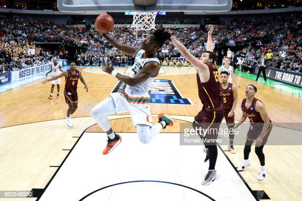Lonnie Walker IV of the Miami Hurricanes goes up for a shot against Cameron Krutwig of the Loyola Ramblers in the first round of the 2018 NCAA Men's...